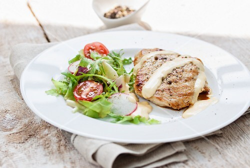 Grilled turkey breast with Hollandaise sauce and a side salad