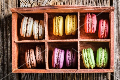 Colourful macaroons in an old wooden box