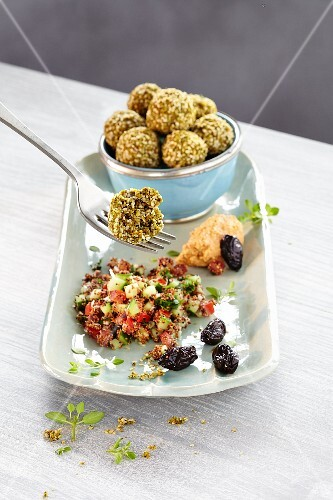 Falafel with cucumber salad and olives