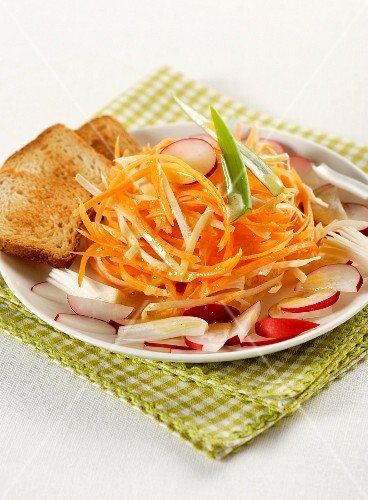 Celery and carrot salad with radishes and toasted bread