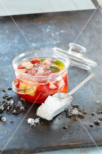 Rhubarb punch with strawberries and crushed ice