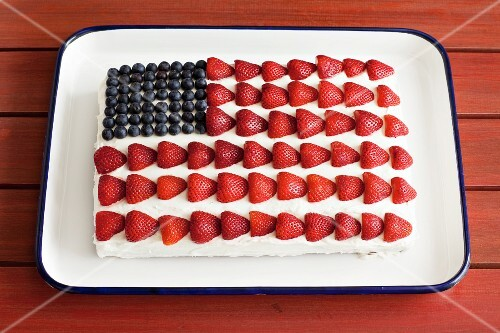 A strawberry and blueberry American flag cake for 4th July
