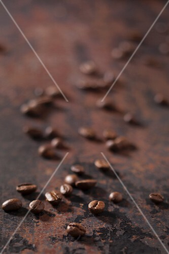 Espresso beans on a rusty surface