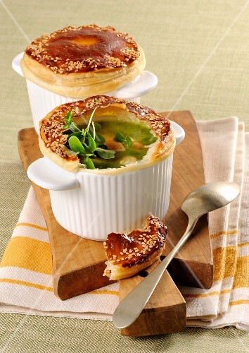 Vegetable soup topped with a puff pastry crust