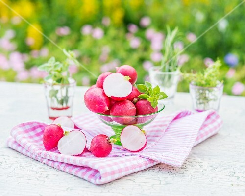 Radishes in a glass bowl and next to it