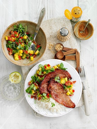 Spicy gammon steaks with rice and salsa