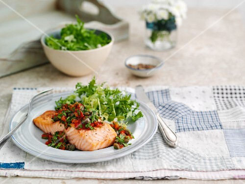 Salmon with a pepper and caper salsa and lettuce