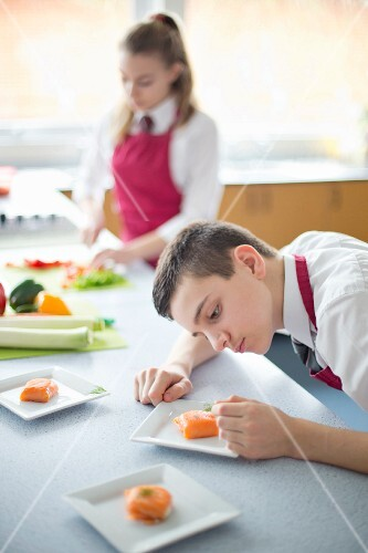 A grammar school student learning to cook in a food technology class