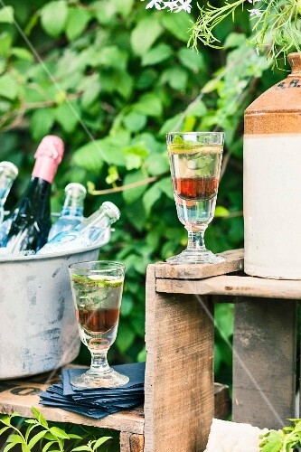 Aperitif with Prosecco and liqueur at a garden party