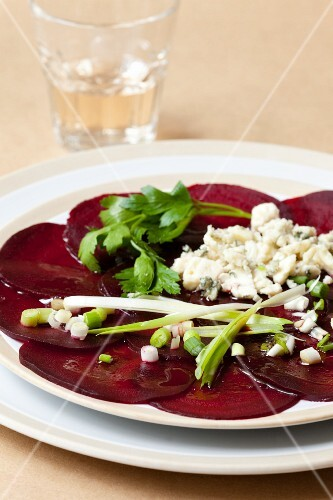 Beetroot carpaccio with spring onions and blue cheese