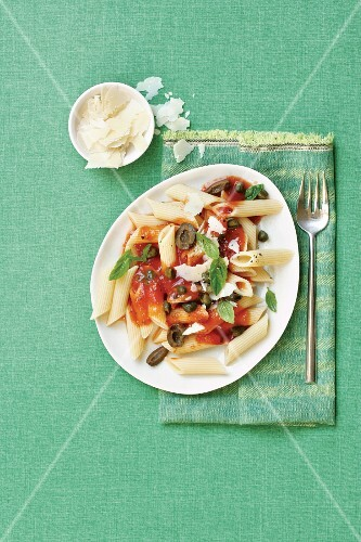Penne puttanesca with tomatoes, olives and capers