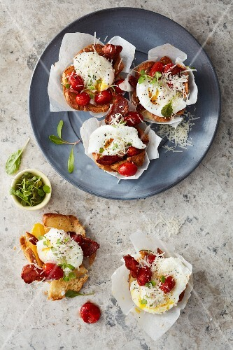 Muffin cups with poached egg, bacon and cherry tomatoes