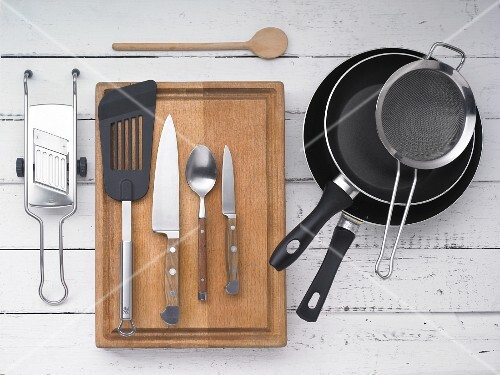 Kitchen utensils: pounds, a sieve, the greater, a spatula and kitchen knives
