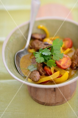 Yellow beef curry with peppers and tomatoes