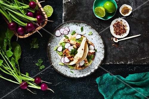 Tacos with chicken and radishes