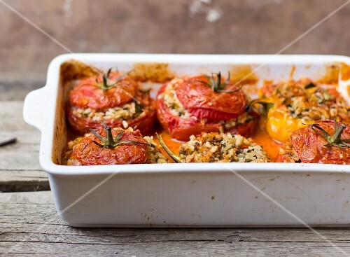 Oven-baked stuffed tomatoes and peppers