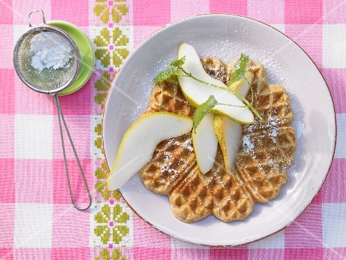 Chestnut waffles with pear wedges
