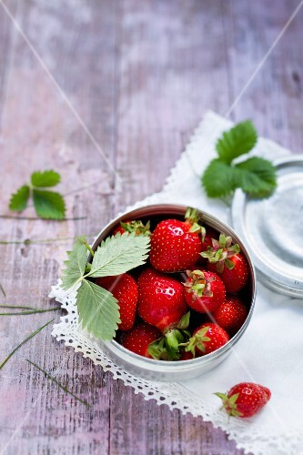 Fresh strawberries in a metal tin