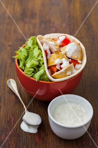 Tortillas with chicken, lettuce and a spicy yoghurt sauce
