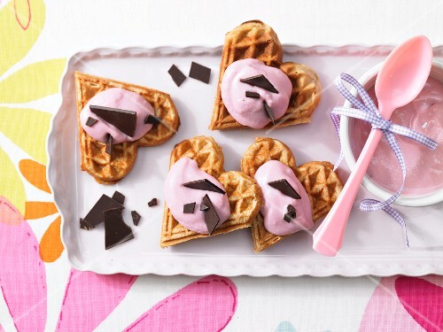 Waffle hearts with raspberry quark and chocolate leaves