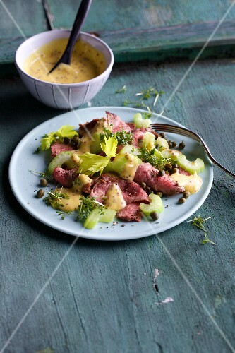 Fine meat salad with roast beef, cucumber, capers and a mustard dressing