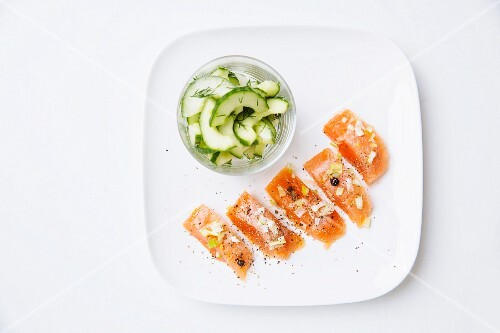 Marinated salmon trout with a cucumber salad and juniper berries