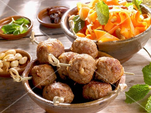 Meatballs with a date, almond and carrot salad