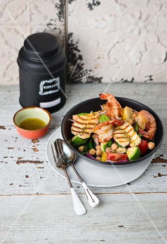 A salad with grilled halloumi, avocado, prawns and chickpeas