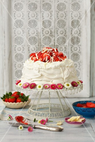 Pavlova with whipped cream and strawberries