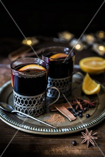 Mulled wine for Christmas with spices and oranges