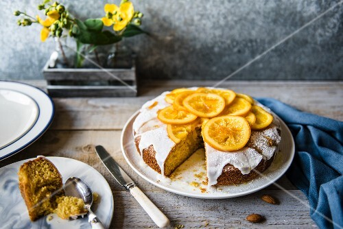 Almond and polenta cake with oranges, sliced