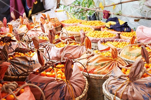 Baskets of kumquats at a market