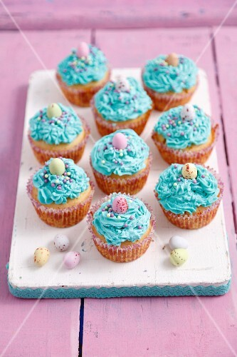 Blue cupcakes with mascarpone frosting and chocolate eggs