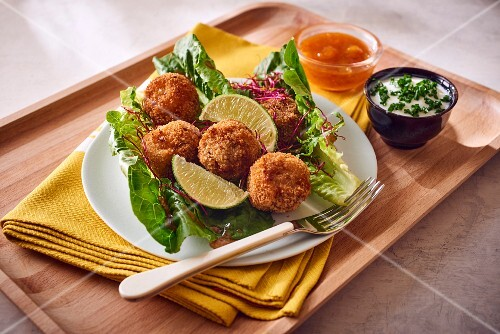 Falafel on lettuce leaves with mango chutney and a yoghurt dip