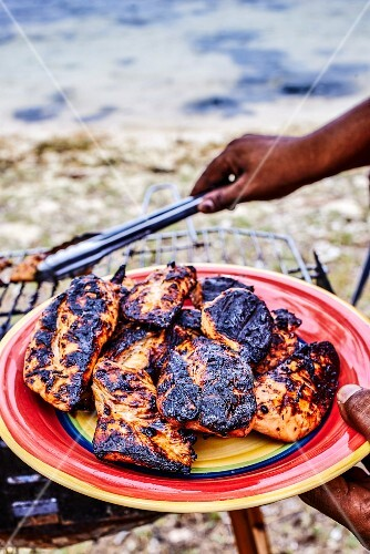Barbecued chicken on a beach