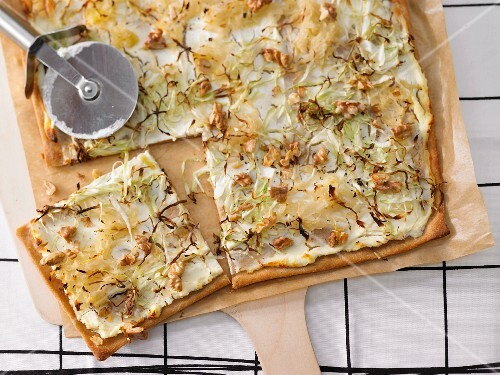 Tarte flambée with cabbage and walnuts