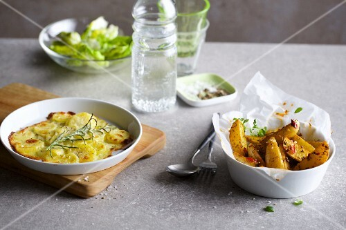 Potato gratin with rosemary and oven-roasted potato wedges with chilli