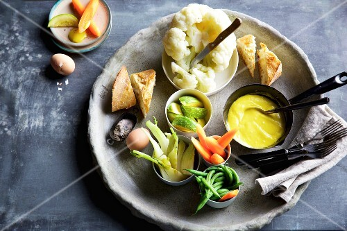 A vegetable platter with aioli