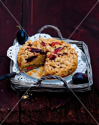Plum crumble cake on a wicker tray
