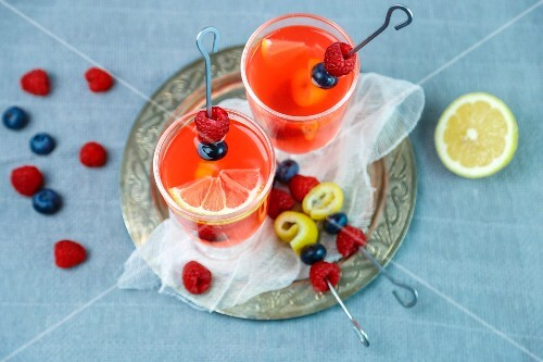 Raspberry lemonade with fruit kebabs