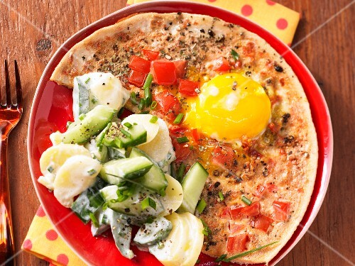 Tomato eggs with a potato and cucumber salad