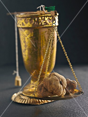 White truffles on a pair of old scales