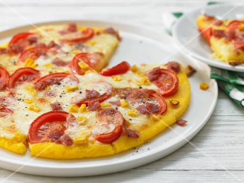 Polenta pizza with salami and sweetcorn