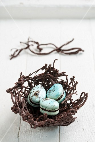 Three blue macarons in an Easter nest
