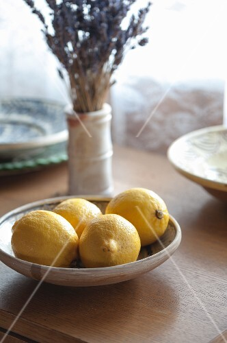Fresh lemons in a bowl on a windowsill