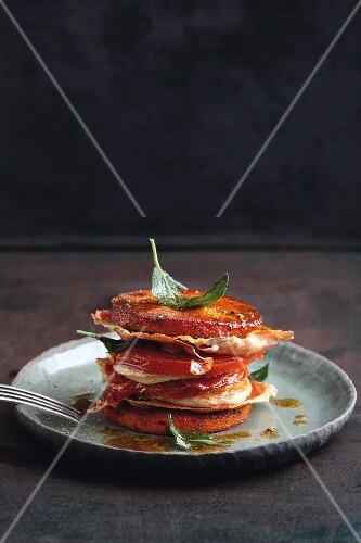 A polenta, tomato, pork escalope and ham tower