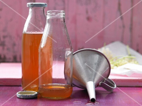 Elderflower syrup in glass bottles
