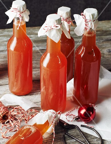 Bottles of homemade quince syrup