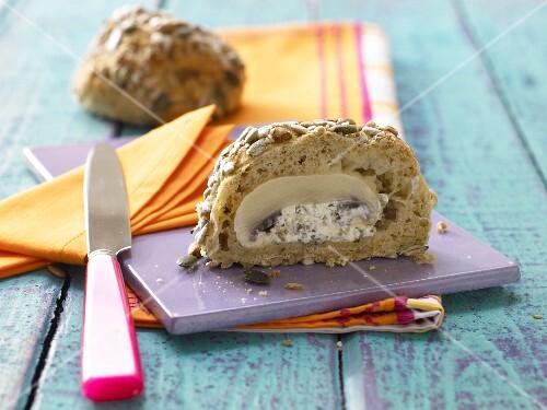 A multi-grain bread roll with a stuffed mushroom
