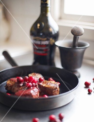 Pork fillet with cherry liqueur and cranberries